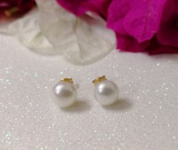 Used 18k solid gold 7mm genuin pearl earings in Dubai, UAE