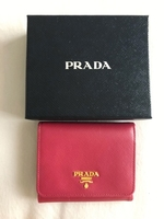 Used Prada rose pink wallet original with box in Dubai, UAE