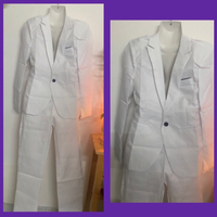 Used White Suit/ M in Dubai, UAE
