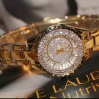 Woman gold Watch with stones