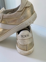Used Tods ladies golden sneaker size 39 in Dubai, UAE
