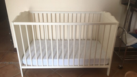 Used Ikea cot with mattress and bed sheets in Dubai, UAE