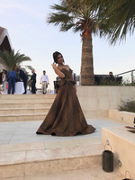 Used Gold and black long evening gown. in Dubai, UAE