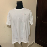 Used Lacoste white t-shirt NEW #authentic  in Dubai, UAE