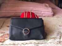 Used Caprese Women's Sling bag (black & gold) in Dubai, UAE