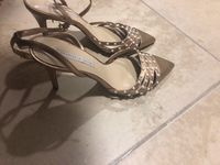 Used Charles and keith golden sandals  in Dubai, UAE