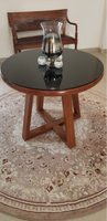 Used Round table with black glass top in Dubai, UAE