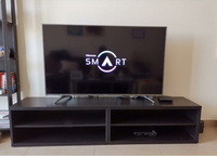 Used TV - Hisense with its table/support  in Dubai, UAE