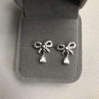 Used 925 silver bow diamond  design earrings  in Dubai, UAE