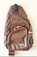 Used Brown Leather Chest Bag with USB Outlet  in Dubai, UAE