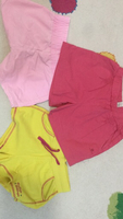 Used 3 pairs of pink and yellow shorts, child in Dubai, UAE