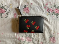 Used Leather cherries wallet in Dubai, UAE