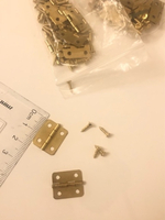 Used 50pcs golden box hinges  in Dubai, UAE