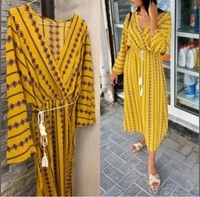 Used Yelloe dress in S size (loose) with belt in Dubai, UAE