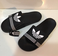Used Adidas slippers size 41, new in Dubai, UAE
