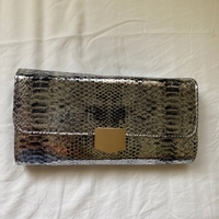 Used Silver and gold clutch  in Dubai, UAE