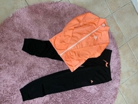 Used Adidas orange suite in Dubai, UAE