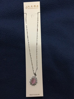 Artificial necklace with pink gem/stone