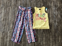Used T-shirt and trousers for a girl 7/8 yo  in Dubai, UAE