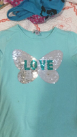 Used Blue shirt. Changeable sequins. Child in Dubai, UAE