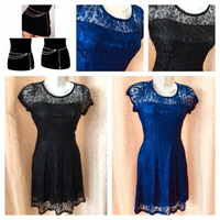 Used 2 lace dresses size M new in Dubai, UAE