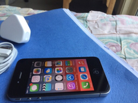Used iPhone4s with original charger brand new in Dubai, UAE