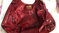 Used  Coach bag, red glowing color in Dubai, UAE