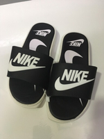 Used Nike kids slippers size 34, new in Dubai, UAE