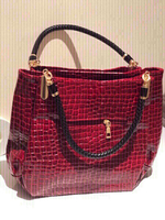 Used Red medium size bag  in Dubai, UAE