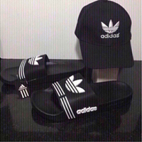 Used 2pcs set adidas cap and slippers size 42 in Dubai, UAE