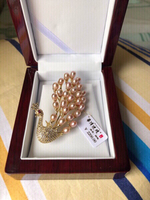 Used New ZhongLian pearl peacock brooch China in Dubai, UAE