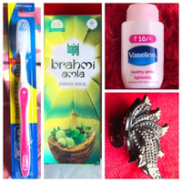 Used New toothbrush,lotion,Hair oil & clip 💝 in Dubai, UAE