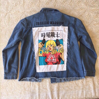 Used Denim jacket with comic girl (size L) in Dubai, UAE