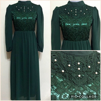 Used Long Dress With Pearls Detail Bodice- Green. Measurements: Chest-88cm, Waist-84cm, Sleeves-57cm, Length-137cm. Brand new. Tailor made. Lining underneath. Polyester material. in Dubai, UAE