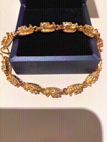 Used 18k gold plated dragon charm bracelet in Dubai, UAE