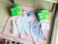 Used Baby romper,diapers,wipes,wrap,bar&brush in Dubai, UAE
