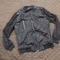 Used Jacket size medium for him in Dubai, UAE