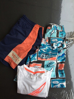 Used 10-12 yrs 2 swim shirts +T-shirt  in Dubai, UAE