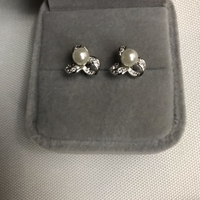 Used 925 silver bow pearl  design earrings in Dubai, UAE