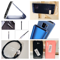 Used 3 phone covers+audio cable+headphones  in Dubai, UAE
