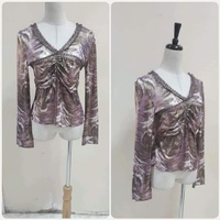 Used Brand new shiny purple Top- small size * in Dubai, UAE
