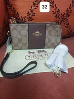 Used Coach wrislet and sling wallet in Dubai, UAE