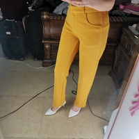 Used PASSION size small yellow trousers in Dubai, UAE