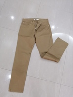 Used Lacoste jeans brown size w34/L34 in Dubai, UAE
