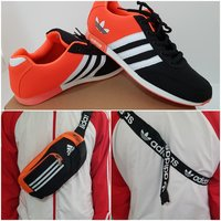Used Adidas shoes and chest bag orange/black. in Dubai, UAE