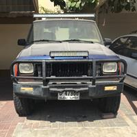 Used Cherokee Model 1996 Blue color ready for the road and the street in Dubai, UAE