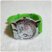 GREEN HELLO KITTY WATCH for her...