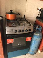 Used Stove with oven and empty gas cylinder in Dubai, UAE