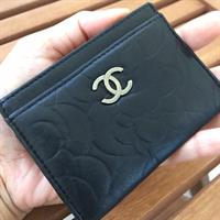 Used CHANEL black lambskin leather camellia cardholder featuring classic Chanel camellia flower and CC silver-stone. Authenticity guaranteed. Pre-loved . No box . Minor fault can be spot in this photo . Used couple of times . Now clearing my closet .  in Dubai, UAE