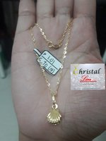 Used 18K REAL GOLD CHAIN WITH SHELL PENDANT in Dubai, UAE